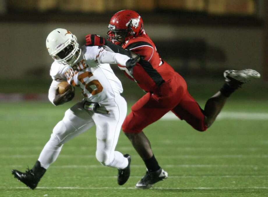 Dobie's Deandre Bolden (16) is brought down for a loss by North Shore's Jarius Moore during the first half of a high school football playoff game, Friday, November 11, 2011 at Galena Park Stadium in Houston. Photo: Eric Christian Smith, For The Chronicle
