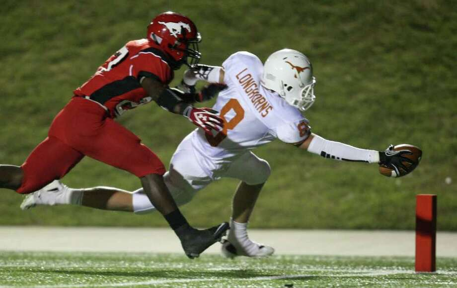 Dobie's Kyle Lohse (8) scores a 35-yard touchdown reception past North Shore's Earnest Thomas during the first half of a high school football playoff game, Friday, November 11, 2011 at Galena Park Stadium in Houston. Photo: Eric Christian Smith, For The Chronicle
