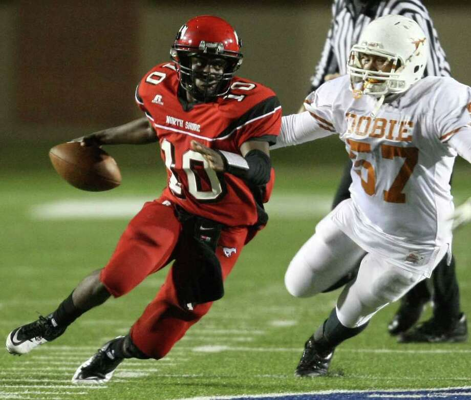 North Shore quarterback Tyrone Newsome (10) scampers past Dobie's Fabian Davalos during the first half of a high school football playoff game, Friday, November 11, 2011 at Galena Park Stadium in Houston. Photo: Eric Christian Smith, For The Chronicle