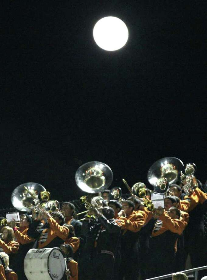 Under a full moon, Dobie's band plays from the stands during the first half of a high school football playoff game against North Shore, Friday, November 11, 2011 at Galena Park Stadium in Houston. Photo: Eric Christian Smith, For The Chronicle