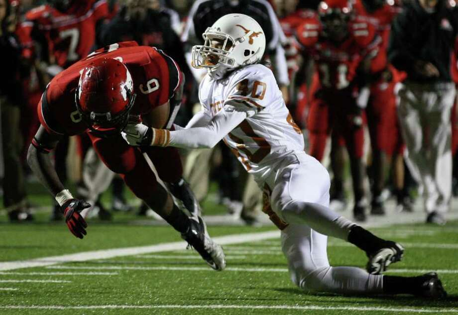 North Shore's Derrick Gillis (6) is tackled by Dobie's Daryl Edwards during the first half of a high school football playoff game, Friday, November 11, 2011 at Galena Park Stadium in Houston. Photo: Eric Christian Smith, For The Chronicle