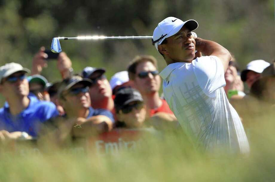 DAVID CANNON: GETTY IMAGES SWEET SWING: Tiger Woods returns to form with a 5-under 67 on Friday that earned him a one-shot lead in the Australian Open. Woods thought he played well enough to go 8 or 9 under. Photo: David Cannon / 2011 Getty Images