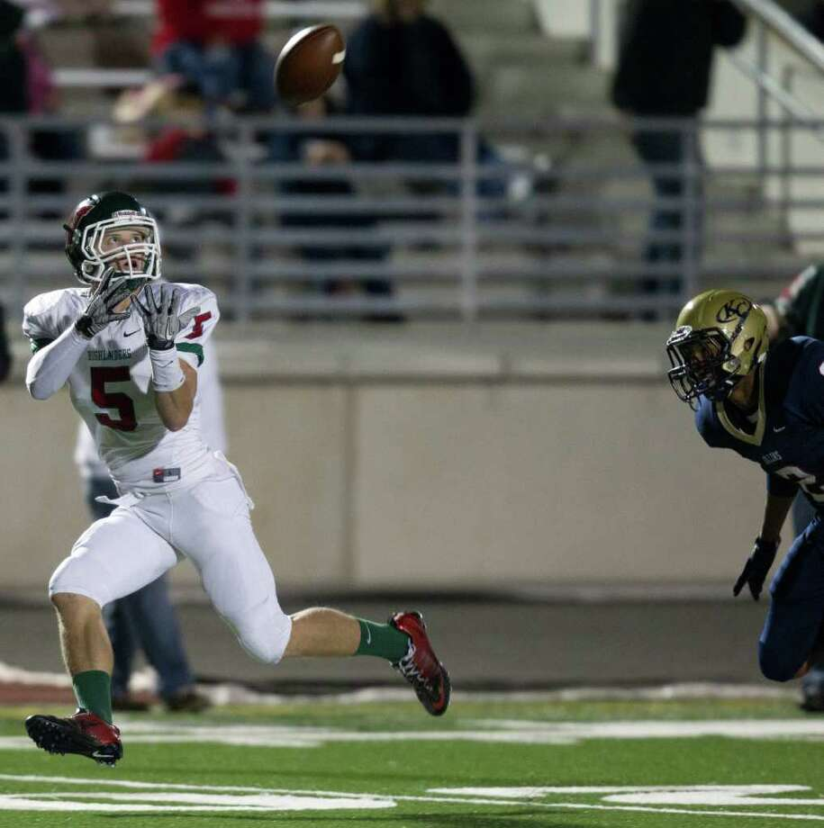 The Woodlands wide receiver Blake Webb (5) hauls in a long touchdown pass after getting past Klein Collins defensive back Jordan Thomas (2) during the second quarter of a high school football playoff game at  Turner Stadium, Friday, Nov. 11, 2011, in Humble. Photo: Smiley N. Pool, Houston Chronicle / © 2011  Houston Chronicle