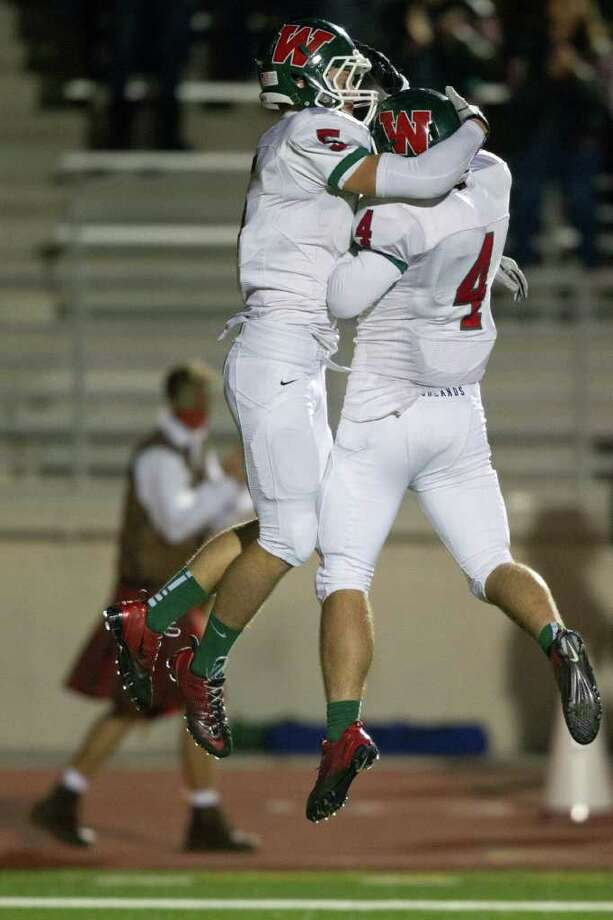 The Woodlands wide receiver Blake Webb (5) celebrates with teammate Christian Jauregui (4) after scoring on a long touchdown pass against Klein Collins during the second quarter of a high school football playoff game at  Turner Stadium, Friday, Nov. 11, 2011, in Humble. Photo: Smiley N. Pool, Houston Chronicle / © 2011  Houston Chronicle