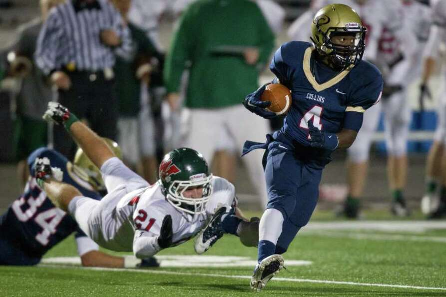Klein Collins running back Shane Rhodes (4) gets past The Woodlands linebacker Cole Little (21) duri