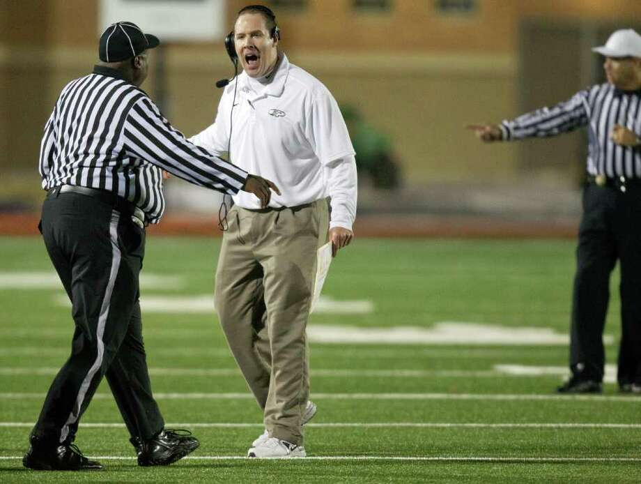 Klein Collins head coach Drew Svoboda argues with an official for a call during the second quarter of a high school football playoff game against The Woodlands at Turner Stadium, Friday, Nov. 11, 2011, in Humble. Photo: Smiley N. Pool, Houston Chronicle / © 2011  Houston Chronicle
