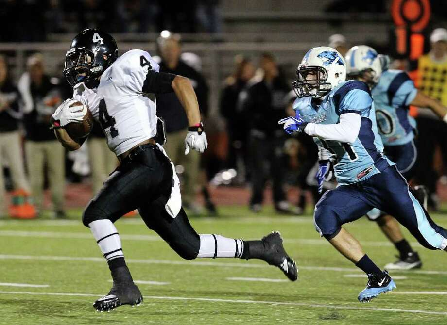 Steele's Justin Stockton (04) breaks away from Johnson's Steven Warren (31) for a first quarter touchdown in Class 5A Division II playoff football at Heroes Stadium on Friday, Nov. 11, 2011. Photo: Kin Man Hui, ~ / San Antonio Express-News