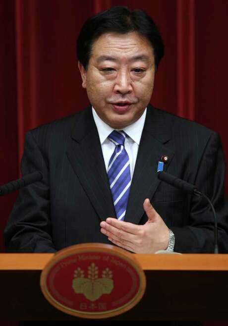 Yoshihiko Noda, Japan's prime minister, speaks during a news conference at the prime minister's official residence in Tokyo, Japan, on Friday, Nov. 11, 2011. Noda said Japan intends to take part in U.S.-led Asia-Pacific trade talks, overriding opposition within his party that an agreement will damage the country's agricultural industry. Photographer: Tomohiro Ohsumi/Bloomberg *** Local Caption *** Yoshihiko Noda Photo: Tomohiro Ohsumi / © 2011 Bloomberg Finance LP
