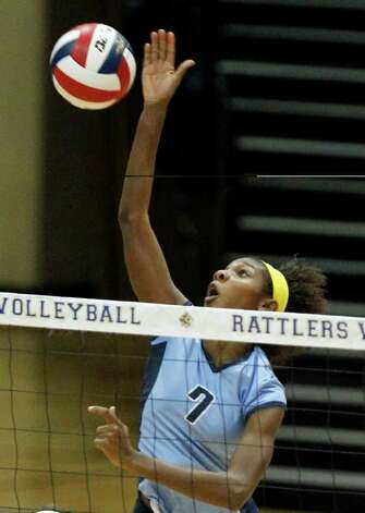 Johnson's Carnae Dillard spikes the ball against Los Fresnos during the Region IV-5A volleyball semifinals at Greehey Arena at St. Mary's University on Friday, Nov. 11, 2011. Johnson won in straight sets (25-12, 25-15, 25-14). MICHAEL MILLER / mmiller@express-news.net Photo: MICHAEL MILLER, Express-News / mmiller@express-news.net