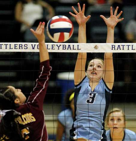 Johnson's Jessica Teel, right, looks to block a spike by Los Fresnos' Ashley Ortega during the Region IV-5A volleyball semifinals at Greehey Arena at St. Mary's University on Friday, Nov. 11, 2011. Johnson won in straight sets (25-12, 25-15, 25-14). MICHAEL MILLER / mmiller@express-news.net Photo: MICHAEL MILLER, Express-News / mmiller@express-news.net