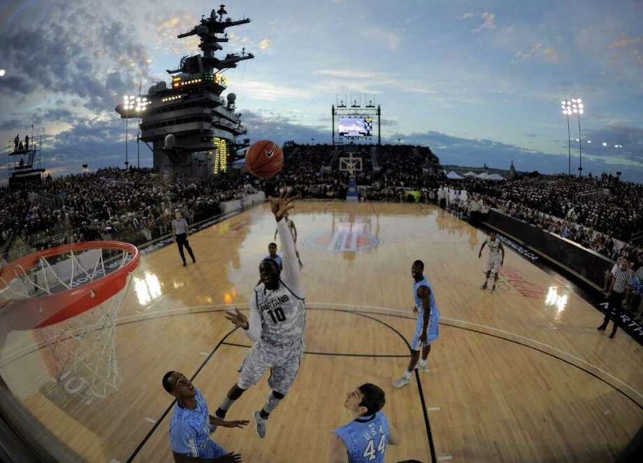 Michigan State forward Draymond Green (10) goes up for a basket during the first half of the Carrier Classic NCAA college basketball game against North Carolina aboard the USS Carl Vinson, Friday, Nov. 11, 2011, in Coronado, Calif. Photo: Mark J. Terrill, Associated Press / AP