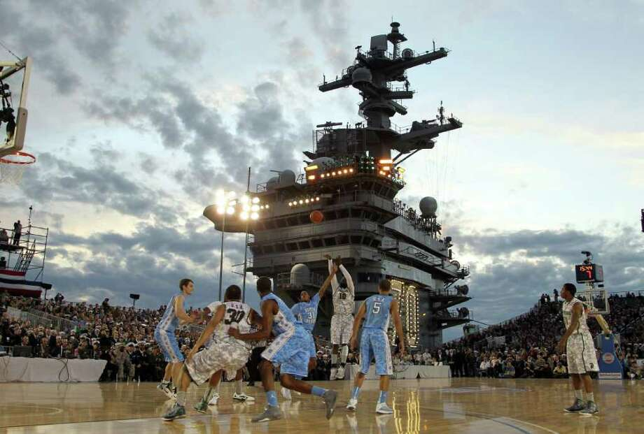 EZRA SHAW : GETTY IMAGES BIG BACKDROP: Michigan State's  Draymond Green takes a jump shot Friday in the game against North Carolina aboard USS Carl Vinson in Coronado, Calif. Photo: Ezra Shaw / 2011 Getty Images