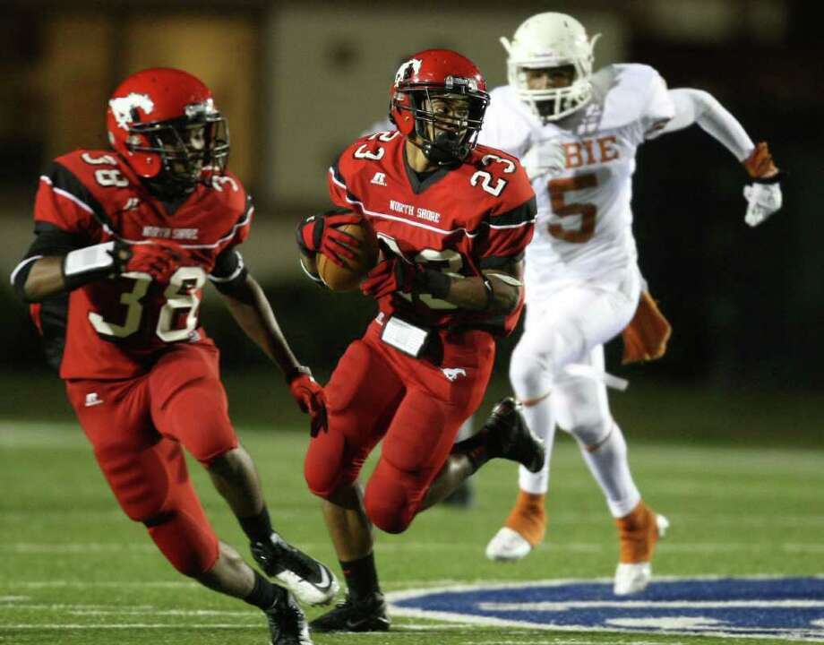 North Shore 34, Dobie 14.North Shore's Jacoby Walker (23) runs back an interception off of Dobie quarterback Deandre Bolden during the second half. Walker had three interceptions in the game, all in the second half. Photo: Eric Christian Smith