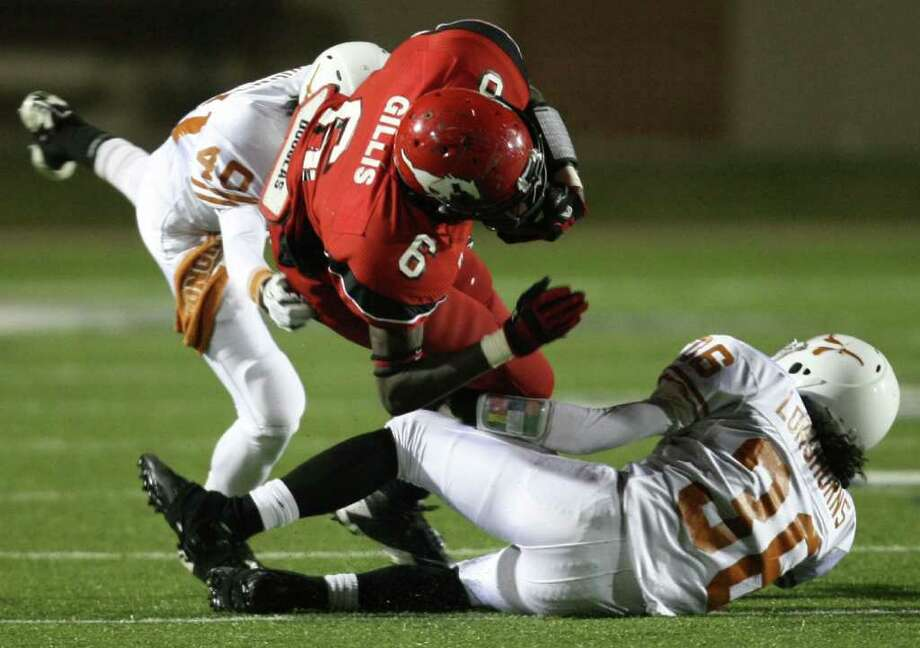 North Shore's Derrick Gillis (6) is tackled by Dobie's Daryl Edwards (40) and Jessy Cedeno during the second half of a high school football playoff game, Friday, November 11, 2011 at Galena Park Stadium in Houston. Photo: Eric Christian Smith