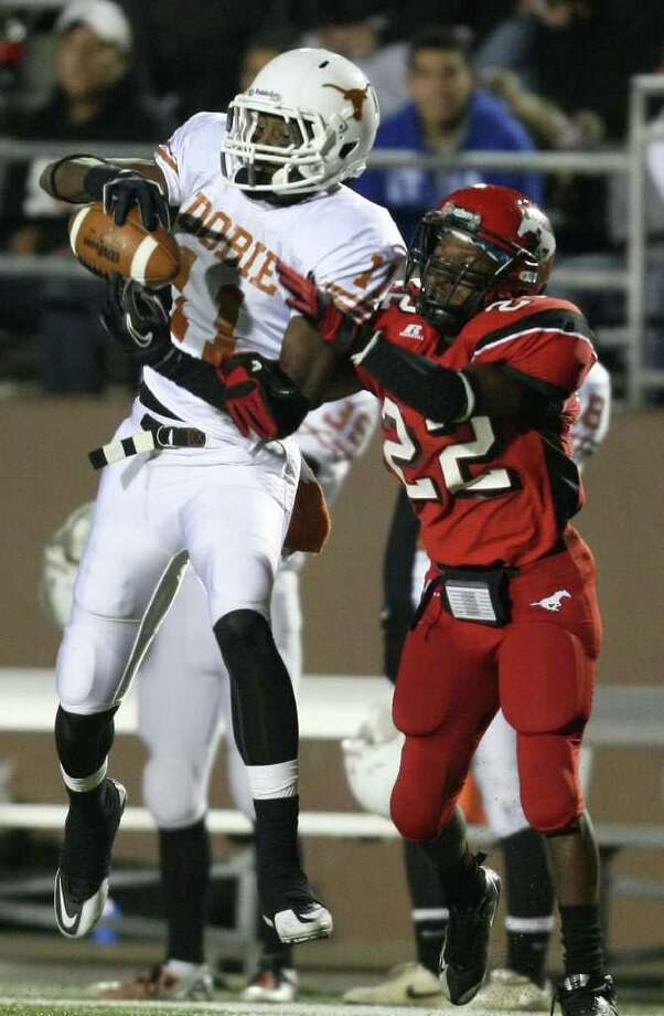 Dobie's Vance Leonard (11) makes a reception as North Shore's Brodrick Thomas defends during the second half of a high school football playoff game, Friday, November 11, 2011 at Galena Park Stadium in Houston. Photo: Eric Christian Smith
