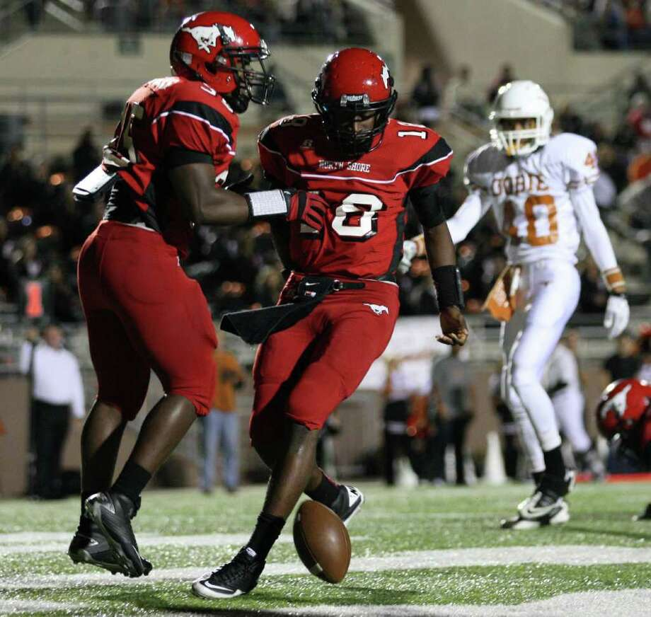 North Shore's Mcah Thomas (18) celebrates his second touchdown of the night with teammate Rodric Simmons during the first half of a high school football playoff game against Dobie, Friday, November 11, 2011 at Galena Park Stadium in Houston. Photo: Eric Christian Smith