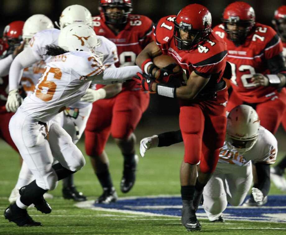 North Shore's Davonte Milton (41) avoids the tackle of Dobie's Jessy Cedeno during the second half of a high school football playoff game, Friday, November 11, 2011 at Galena Park Stadium in Houston. Photo: Eric Christian Smith