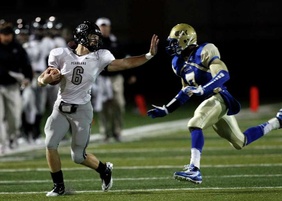 Pearland 41, Elkins 0. Pearland's John Gibberman, left, prepares to give Elkins defender Corey Thompson a stiff arm Friday night. Photo: Bob Levey / ©2011 Bob Levey