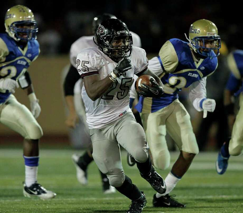 Pearland running back Jackie Robinson #25 breaks loose for a long run against Elkins during a first round playoff game between the Pearland Oilers and Elkins Knights Friday, November 11, 2011 in Alvin, Texas, Photo: Bob Levey / ©2011 Bob Levey