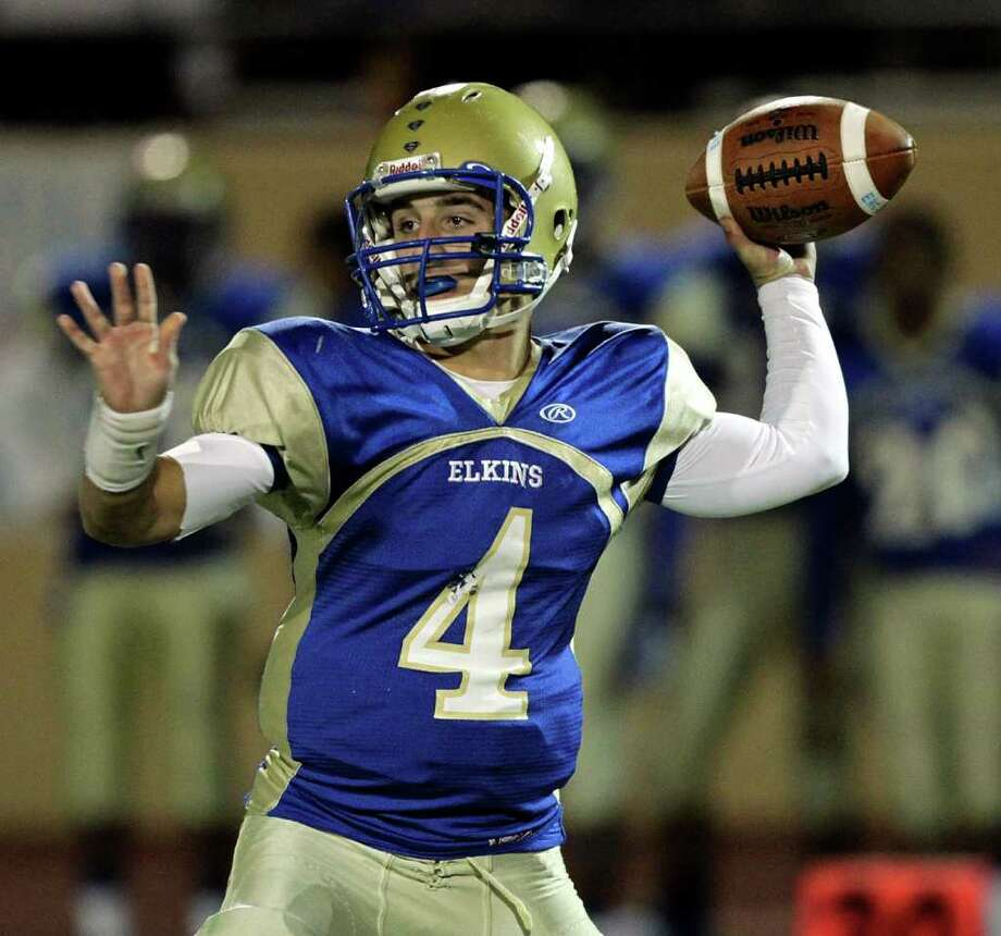 Elkins quarterback Jake Burkhalter #4 throws in the third quarter during a first round playoff game between the Pearland Oilers and Elkins Knights Friday, November 11, 2011 in Alvin, Texas, Photo: Bob Levey / ©2011 Bob Levey