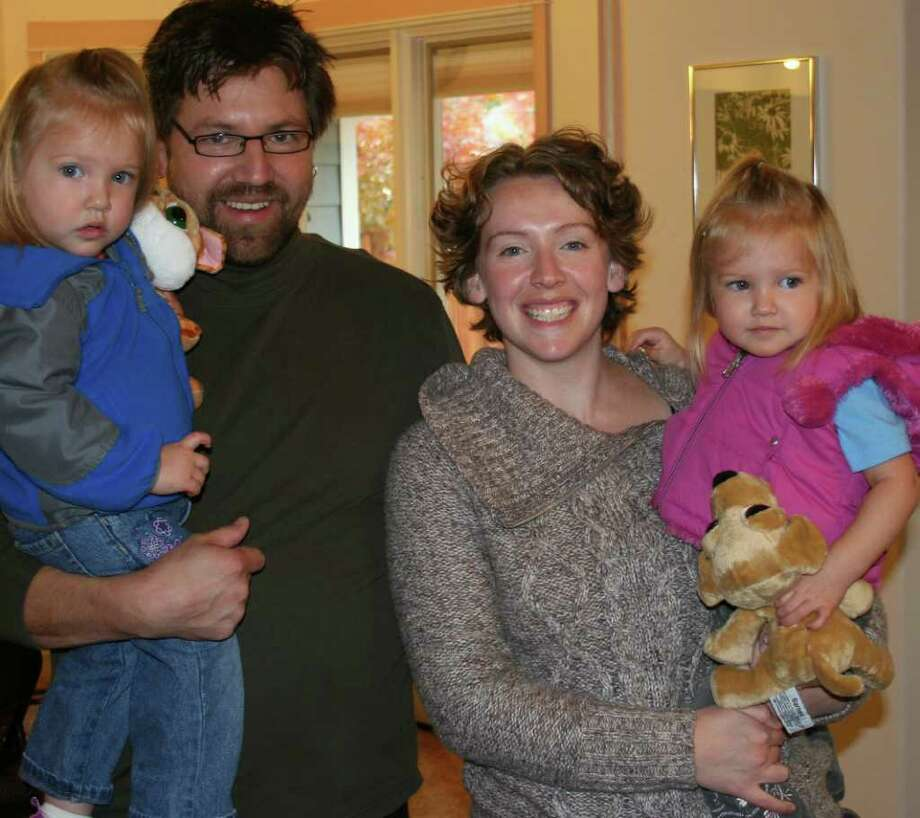 FAMILY PHOTO XXXXXXXXXXXX: This October, 2010 photo provided by the Holstein family, shows Stephanie Holstein with her husband, Doug, and twin daughters Zell and Moxie, in Missoula, Mont. Stephanie said the Income-Based Repayment program, helped keep her student loan payments manageable at a time when money was tight.(AP Photo Gile Mitchell) Photo: Gile Mitchell / Holstein Family