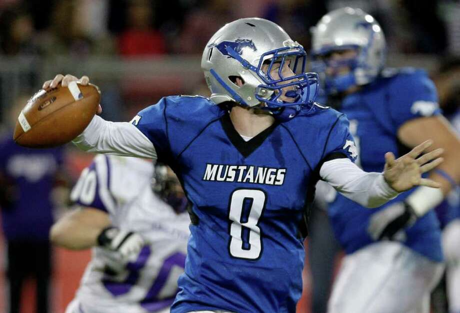 Quarterback Jordan Wood (8) of the Friendswood Mustangs scrambles in the pocket against the Angleton Wildcats  while playing in the first half of a playoff high school football game on November 11, 2011 at Robertson Stadium in Houston, Texas.  Photo: Thomas B. Shea / © 2011 Thomas B. Shea
