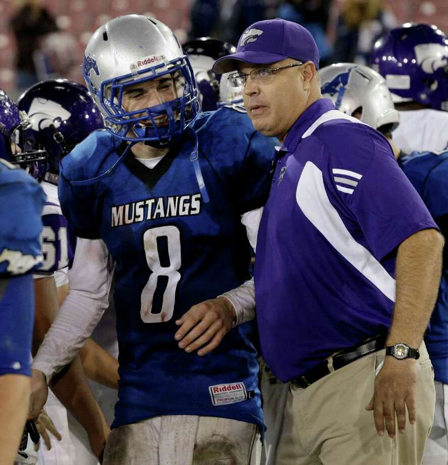 Head coach Ryan Roark of the Angleton Wildcats congratulates quarterback Jordan Wood (8) of the Friendswood Mustangs after the game in a playoff high school football game on November 11, 2011 at Robertson Stadium in Houston, Texas.  Photo: Thomas B. Shea, For The Cronicle / © 2011 Thomas B. Shea