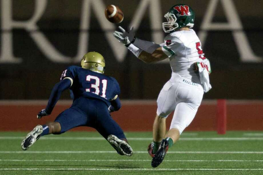 Smiley N. Pool: CHronicle IN GOOD HANDS: The Woodlands wide receiver Blake Webb, right, beats Klein Collins defensive back Ryan Santos on a long first-quarter touchdown catch. Webb wound up with seven receptions for 199 yards and three touchdowns. Photo: Smiley N. Pool / © 2011  Houston Chronicle