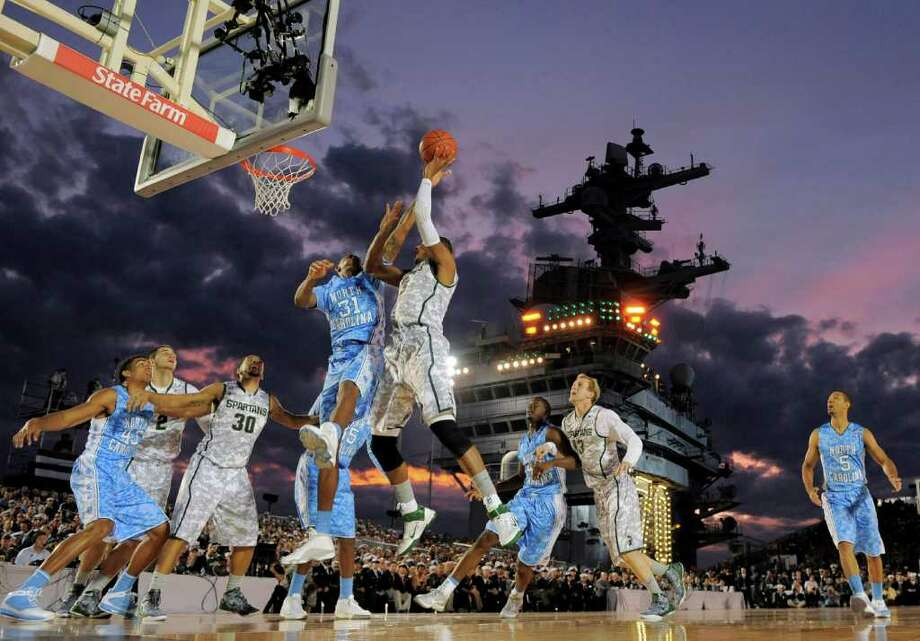 North Carolina forward John Henson (31) tries to block a shot by Michigan State center Adreian Payne (5) during the first half of the Carrier Classic NCAA college basketball game aboard the USS Carl Vinson, Friday, Nov. 11, 2011, in Coronado, Calif.  (AP Photo/Mark J. Terrill) Photo: Mark J. Terrill