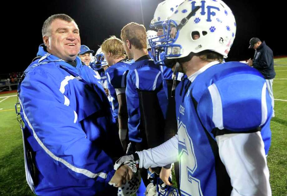 Hoosick Falls' coach Ron Jones congratulates his players as they win the Class C state quarterfinal football game 47-13 over Saranac Lake on Friday, Nov. 11, 2011, at Stillwater High in Stillwater, N.Y. (Cindy Schultz / Times Union) Photo: Cindy Schultz / 00015330A