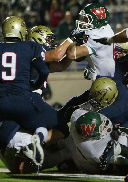 The Woodlands running back Cooper Woodyard (6) pushes his way in for a short-yardage touchdown again