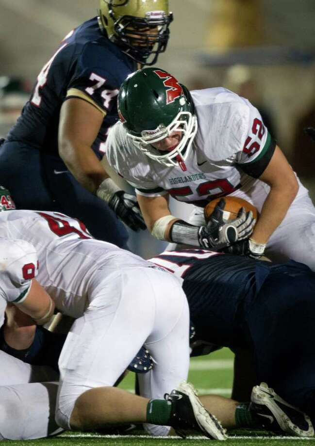 The Woodlands linebacker Brandon Taylor (52) scoops up a Klein Collins fumble during  fourth quarter of a high school football playoff game at Turner Stadium, Friday, Nov. 11, 2011, in Humble. The Woodlands won the game 42-31. Photo: Smiley N. Pool, Houston Chronicle / © 2011  Houston Chronicle