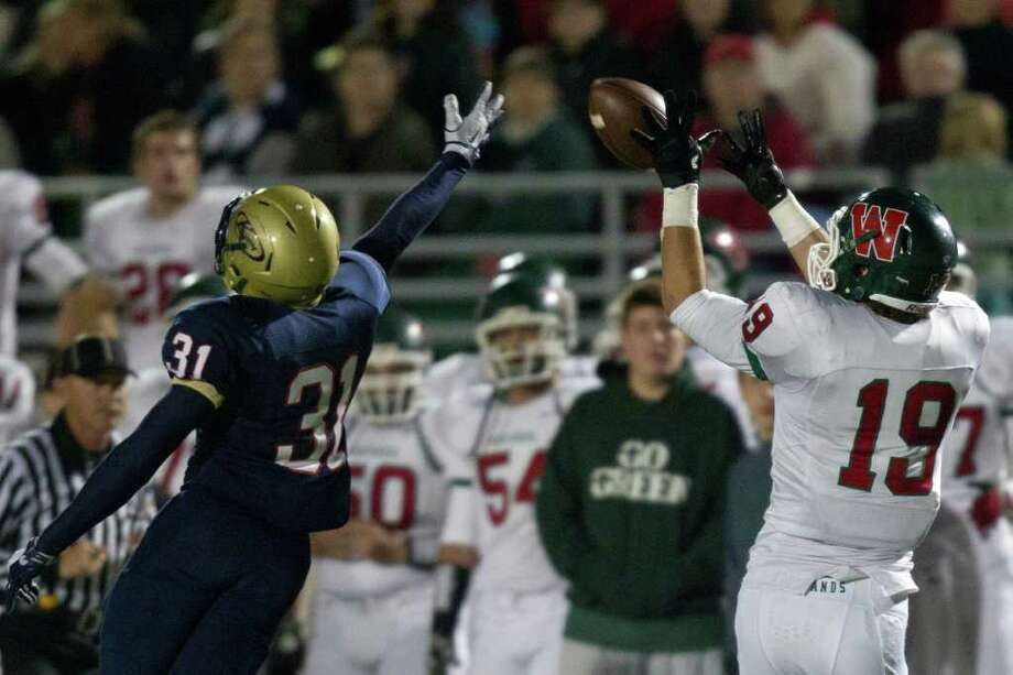 The Woodlands wide receiver Jayme Taylor (19) makes a catch past Klein Collins defensive back Ryan Santos (31) during the third quarter of a high school football playoff game at Turner Stadium, Friday, Nov. 11, 2011, in Humble. Photo: Smiley N. Pool, Houston Chronicle / © 2011  Houston Chronicle