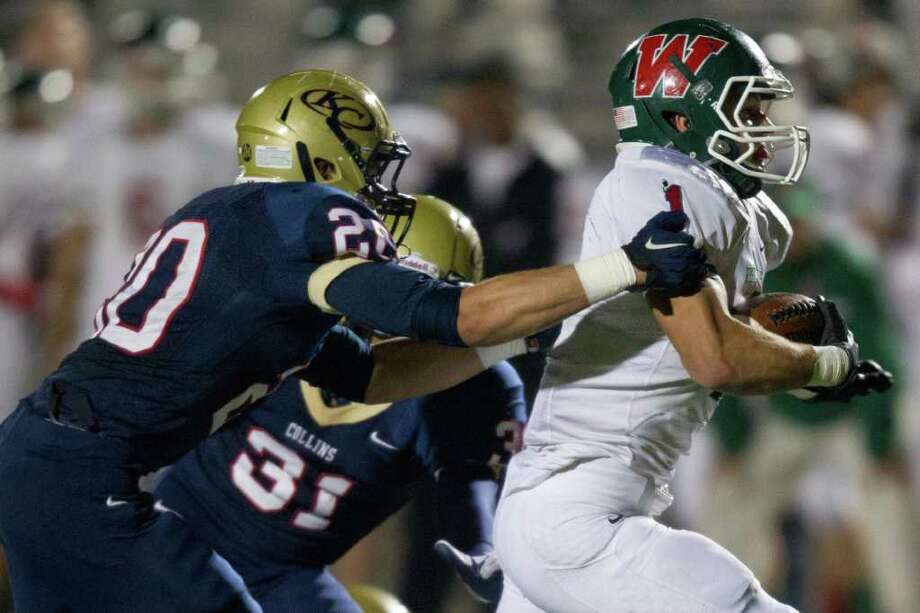 The Woodlands running back Randy Cooper (1) races past Klein Collins linebacker David Nebel (20) for a touchdown during the third quarter of a high school football playoff game at Turner Stadium, Friday, Nov. 11, 2011, in Humble. Photo: Smiley N. Pool, Houston Chronicle / © 2011  Houston Chronicle