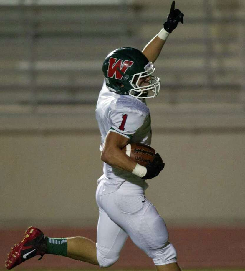 The Woodlands running back Randy Cooper (1) celebrates as he scores a touchdown against Klein Collins during the third quarter of a high school football playoff game at Turner Stadium, Friday, Nov. 11, 2011, in Humble. Photo: Smiley N. Pool, Houston Chronicle / © 2011  Houston Chronicle