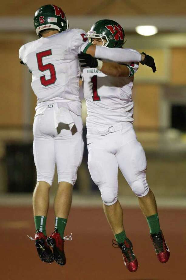 The Woodlands running back Randy Cooper (1) celebrates with wide receiver Blake Webb (5) after scoring a touchdown against Klein Collins during the third quarter of a high school football playoff game at Turner Stadium, Friday, Nov. 11, 2011, in Humble. Photo: Smiley N. Pool, Houston Chronicle / © 2011  Houston Chronicle