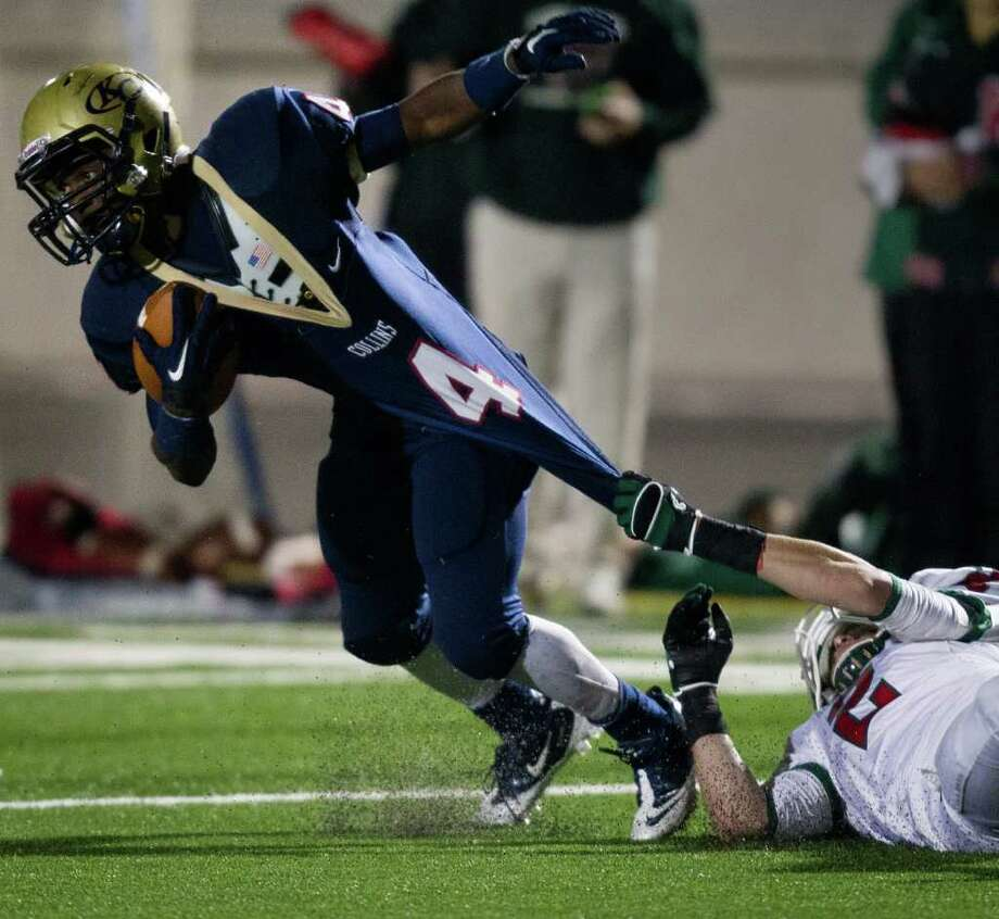 Klein Collins running back Shane Rhodes (4) is dragged down by The Woodlands defensive back Lane LeBouef (2) during the third quarter of a high school football playoff game at Turner Stadium, Friday, Nov. 11, 2011, in Humble. Photo: Smiley N. Pool, Houston Chronicle / © 2011  Houston Chronicle