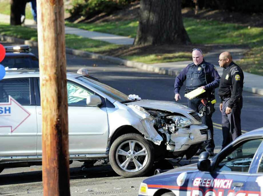 Greenwich car wash worker struck by suv greenwichtime two greenwich police officers inspect a wrecked vehicle on east weaver street that was involved in solutioingenieria Choice Image