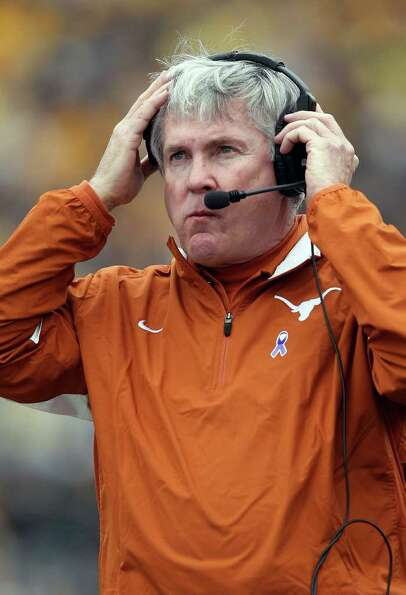COLUMBIA, MO - NOVEMBER 12:  Head coach Mack Brown of the Texas Longhorns watches from the sidelines