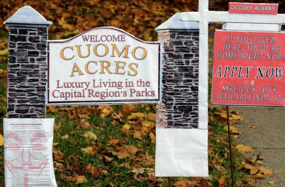 An Occupy Albany sign is seen in Lafayette Park, which is owned by the state. Some say they are upset with the governor's reaction to their protest. ( Michael P. Farrell/Times Union)