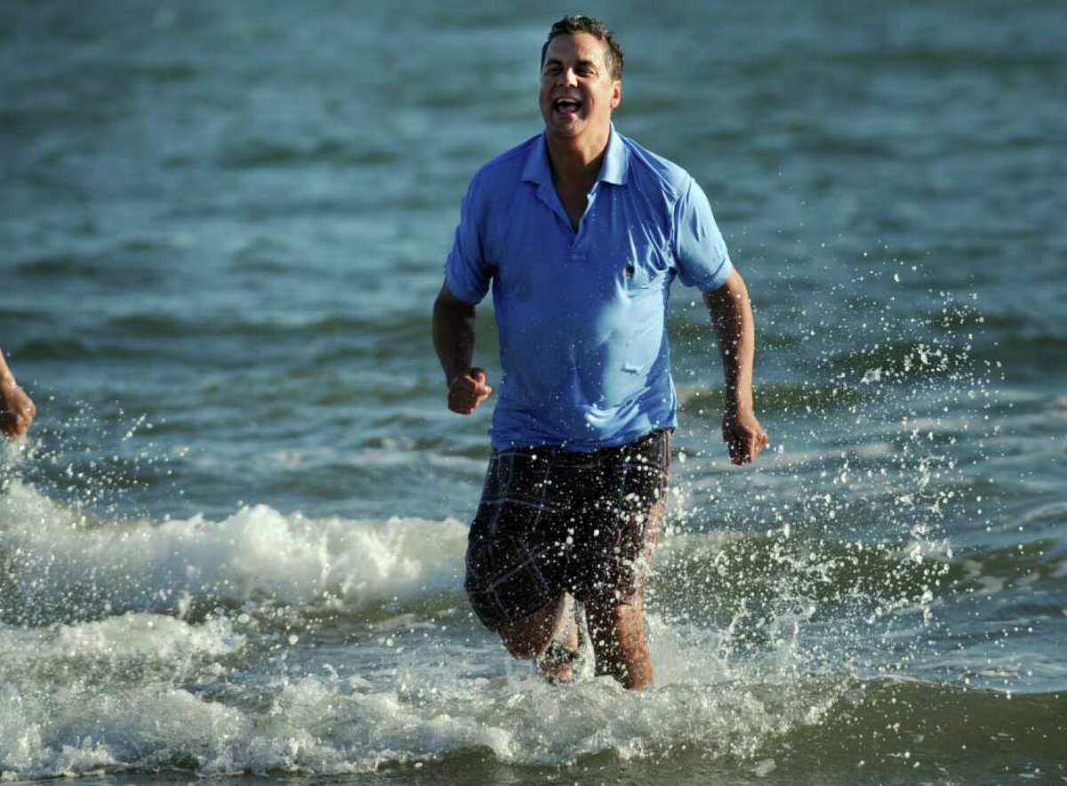 Bridgeport Police Chief Joseph Gaudett runs out of the water during the first Seaside Park Splash and Stroll presented by Bridgeport law enforcement to benefit Special Olympics Saturday, Nov. 12, 2011 at Seaside Park in Bridgeport, Conn.
