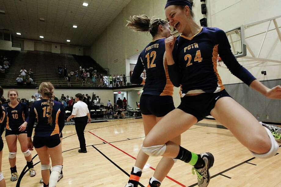 Poth's Micah Weaver (24) leaps jubilantly with teammate Jordan Kotara (12) after their team defeated Marion in the Region IV-2A volleyball championship game at Littleton Gym on Saturday, Nov. 12, 2011. Poth defeated Marion in three straight to move onto the state tournament. Photo: Kin Man Hui, ~ / San Antonio Express-News
