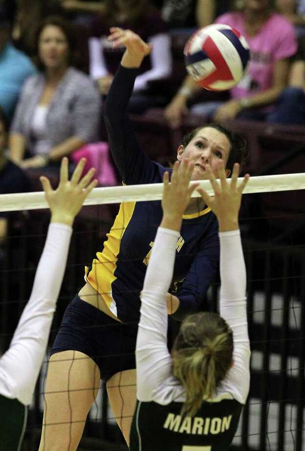 Poth's Kelsee Felux (14) goes for a kill against Marion during the Region IV-2A volleyball championship game at Littleton Gym on Saturday, Nov. 12, 2011. Poth defeated Marion in three straight games to move onto the state tournament. Photo: Kin Man Hui, ~ / San Antonio Express-News