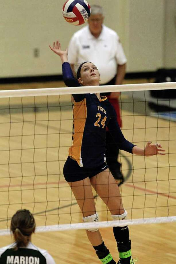 Poth's Micah Weaver (24) attempts a shot against Marion in the Region IV-2A volleyball championship game at Littleton Gym on Saturday, Nov. 12, 2011. Poth defeated Marion in three straight games to move onto the state tournament. Photo: Kin Man Hui, ~ / San Antonio Express-News