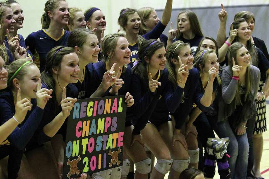 Members of the Poth volleyball team pose for pictures from family members and fans after they defeated Marion in the Region IV-2A volleyball championship game at Littleton Gym on Saturday, Nov. 12, 2011. Poth defeated Marion in three straight games to move onto the state tournament. Photo: Kin Man Hui, ~ / San Antonio Express-News