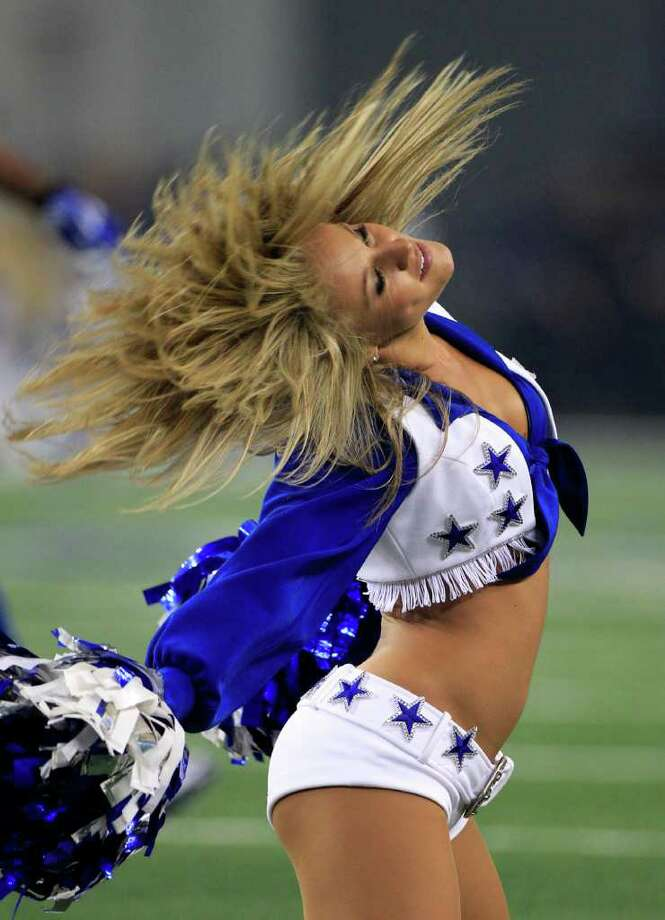 A member of the Dallas Cowboys cheerleaders performs during an NFL football game against the Seattle Seahawks Sunday Nov. 6, 2011, in Arlington, Texas. (AP Photo/Tony Gutierrez) Photo: Tony Gutierrez, STF / AP