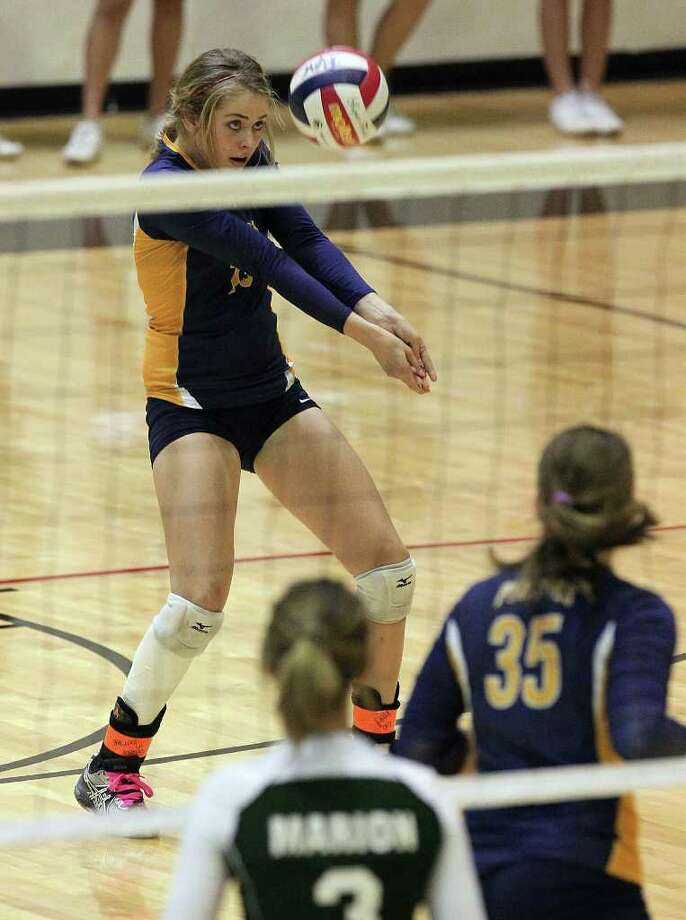 Poth's Corin Nelson (15) eyes a return versus Marion in the Region IV-2A volleyball championship game at Littleton Gym on Saturday, Nov. 12, 2011. Poth defeated Marion in three straight games to move onto the state tournament. Photo: Kin Man Hui, ~ / San Antonio Express-News