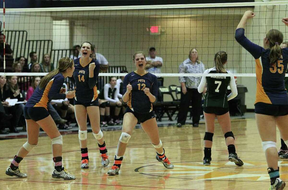 Poth's Jordan Kotara (12) reacts with teammates after winning a point versus Marion in the Region IV-2A volleyball championship game at Littleton Gym on Saturday, Nov. 12, 2011. Poth defeated Marion in three straight games to move onto the state tournament.