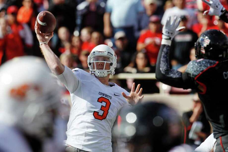 Oklahoma State quarterback Brandon Weeden threw for 423 yards and five touchdowns in a rout of Texas Tech. Photo: AP