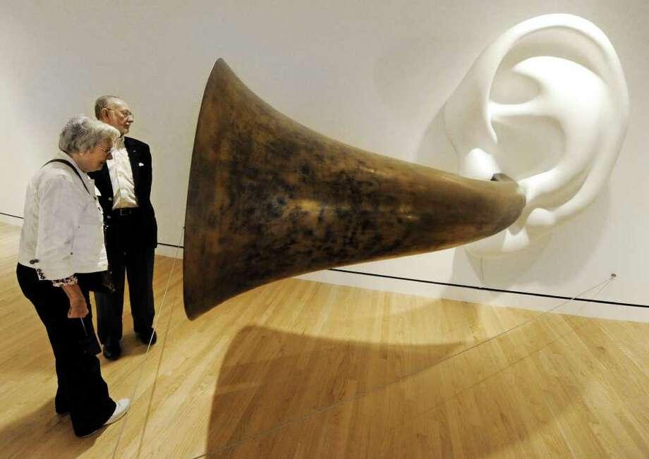 Walter and Jackie Walker, of Little Rock, Ark., listen to John Baldessari's Beethoven's Trumpet (with Ear) Opus #132 at the now-open Crystal Bridges Museum of American Art in Bentonville, Ark. Photo: T. Rob Brown, Associated Press / The Joplin Globe